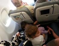 Infants escaping from the safety of car seats while mid-air.