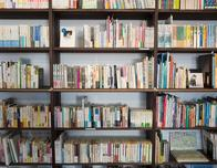 Library shelf of assorted books, from pixabay