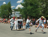 Breck locals compete in the annual Outhouse Races each summer.