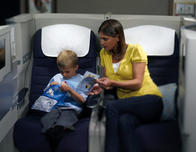 Mother and son traveling on British Airways flight.