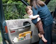 Car_Rental_baby_getting_into_car_993753053