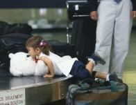 Looking for lovies at baggage claim, but mind their little fingers.
