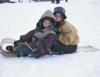 children_on_sled_410670665