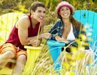 teen_boy_and_girl_in_lawn_chairs_910080126