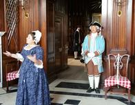 Reenactors lead a tour of the Governor's Palace at Colonial Williamsburg.