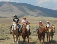 Dude Ranch family on horseback, c. DudeRanch.org