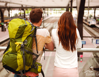 Eurail photo, couple watching trains in European station.