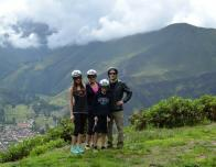 Family taking a break from a horseback ride in the Andes, overlooking the Sacred Valley