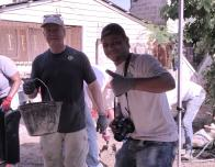 Fathom travelers help pour concrete floors for local families.