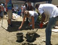 Fathom travelers work with fresh concrete