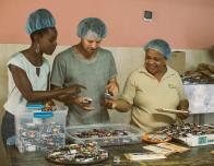 Fathom Cruise, working in cacao factory.