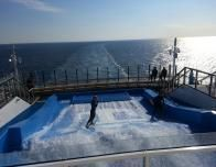 Flowrider surf simulator makes it possible to boogie board or surf on deck.