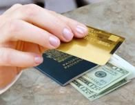 Foreign transactions require travelers to be armed with currency and plastic.