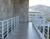 This image shows parts of the Getty architecture. It was taken from the upper levels of the Getty Museum, and one can see another section of the Getty in the background.