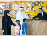 Muslim family checking in at hotel in UAE.