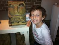 Hannah Poses with a Stone Sculpture at Sint Janskirt