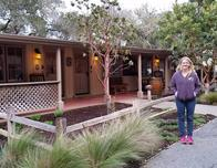 A cottage at Holman Ranch, Mary outside
