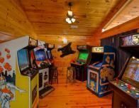 This Tennessee mountain cabin has its own game arcade; photo courtesy Homeaway.com