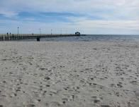 Pier along Biloxi's white sand Gulf coast beach.