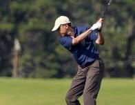 Ping: Barack Obama tees off while playing golf at the Vineyard Golf Club in Edgartown