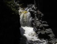Sunlit Falls in Dark Temperance River Canyon_0
