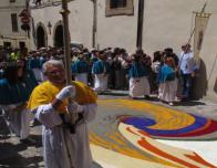 Church processional passes through Spello during Infiorata Festival.