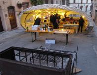 Spello team works overnight in street to prepare flower painting.