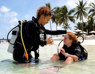The kids program at Conrad Maldives teaches basic scuba diving skills.