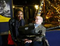 Touring the Science Museum, London with Prof. Stephen Hawking; Apollo 11 lunar module in background.
