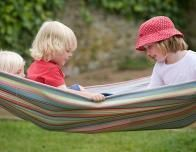 Chatting in a Hammock at Moonfleet Manor, West Dorset, Britain