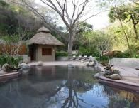 Matlali has a natural stone pool and yoga deck in a shaded back garden.