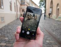 Smartphone taking photo in old town.
