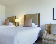 Hyatt rooms with two queen beds have a pullout sofabed as well to accommodate larger families.