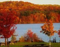 Fall colors are especially vivid near bodies of water, as you can see in Pennsylvania.