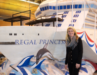 Princess Cruises President Jan Swartz shows off model of latest ship, Regan Princess.