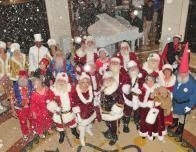Santas from every department greet Princess Cruise Lines guests at the holidays.