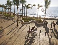 You can easily walk or bike along the paved seaside .