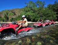Adventure tour operators run ATV trips through local rivers and forests.