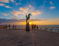 Waterfront Malecon of Puerto Vallarta at sunset.