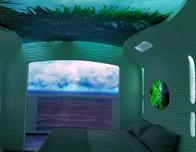 Royal Caribbean's stateroom of the future at night.