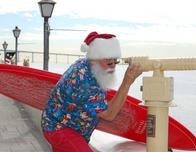 Surfing Santa comes to Seaport Village in San Diego in December.