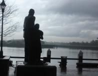A Father and Daughter Gaze Out at Savannah's Port
