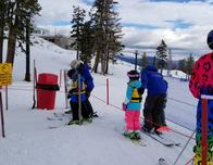 Dedicated ski school staff introduce beginners to snow sports at the top of the mountain.