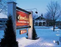 Stoweflake entry draped in winter's snowfall