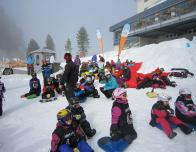 Mount Titlis ski school pauses for a break at an on-mountain lodge.