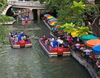 View of the colorful cafes of the Riverwalk from a shoreline hotel