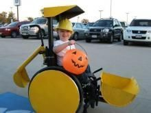 Boy in wheelchair goes Trick or Treating on Halloween