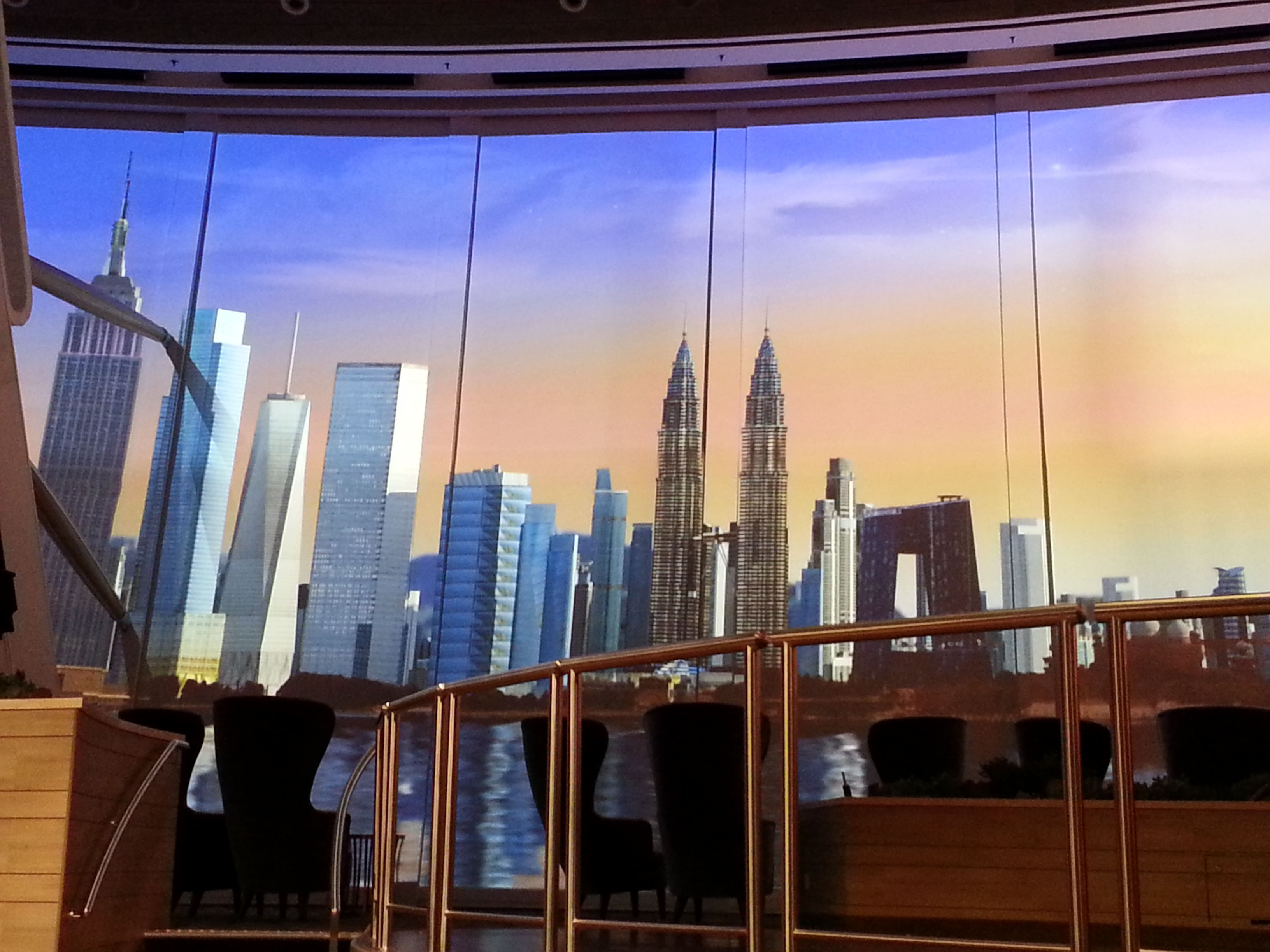 First look at quantum of the seas royal caribbeans latest ship the two70 degree lounge shows a world skyline on vistarama words altavistaventures